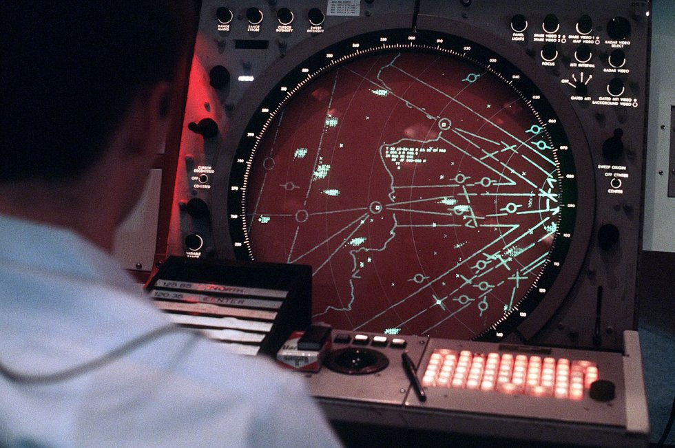 An_airman_monitors_the_new_display_console_for_the_AN-FPS-117_air_defense_radar_system_at_Temp...jpg