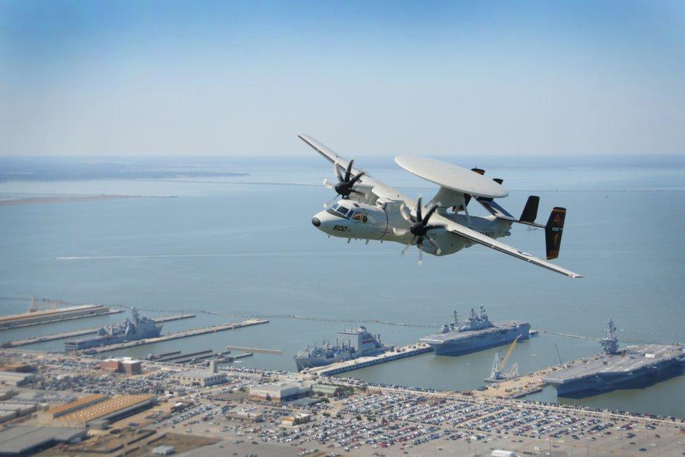 An_E-2D_Hawkeye_flies_over_Naval_Base_Norfolk_(13315193084).jpg
