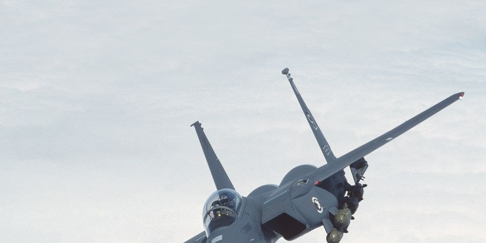 boeing-f-15e-strike-eagle-flying-enroute-above-a-layer-of-news-photo-973343852-1550605754.jpg