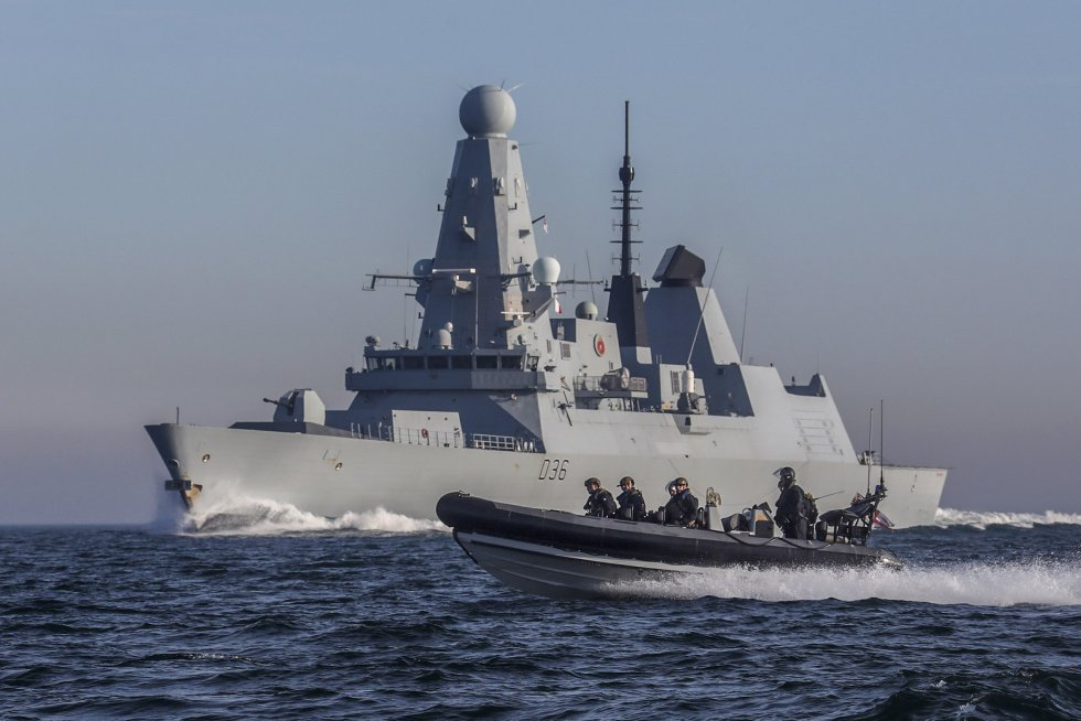 HMS Defender with her sea boat in the foreground.jpg