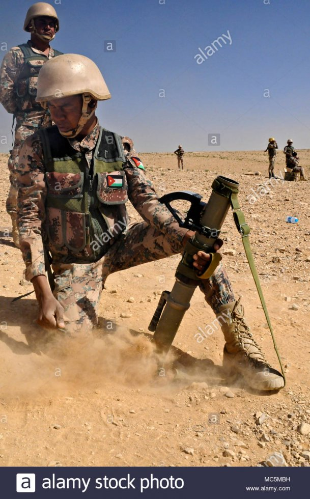 joint-training-cener-a-jordan-armed-forces-with-the11th-border-security-soldier-fires-a-60-mm-...jpg