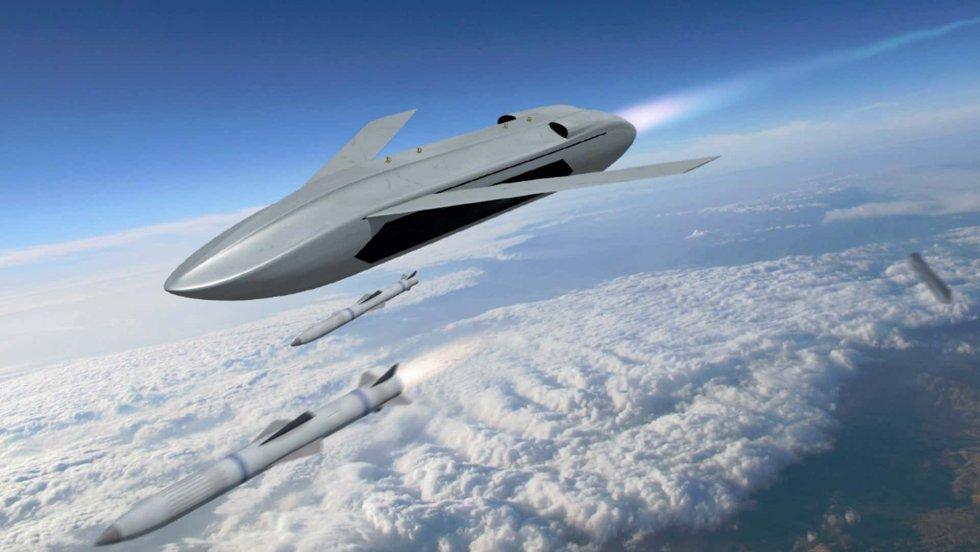 message-editor_1627417534677-darpa-drone-firing-missile.jpeg